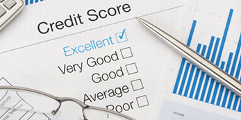 Credit score ratings on a paper with Excellent check marked